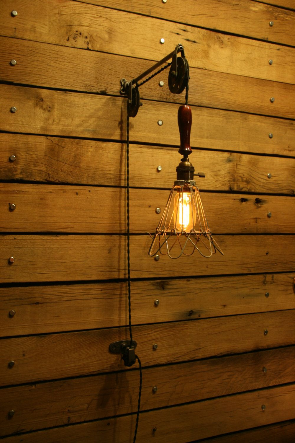 Industrial trouble light pulley wall sconce with wooden handle and