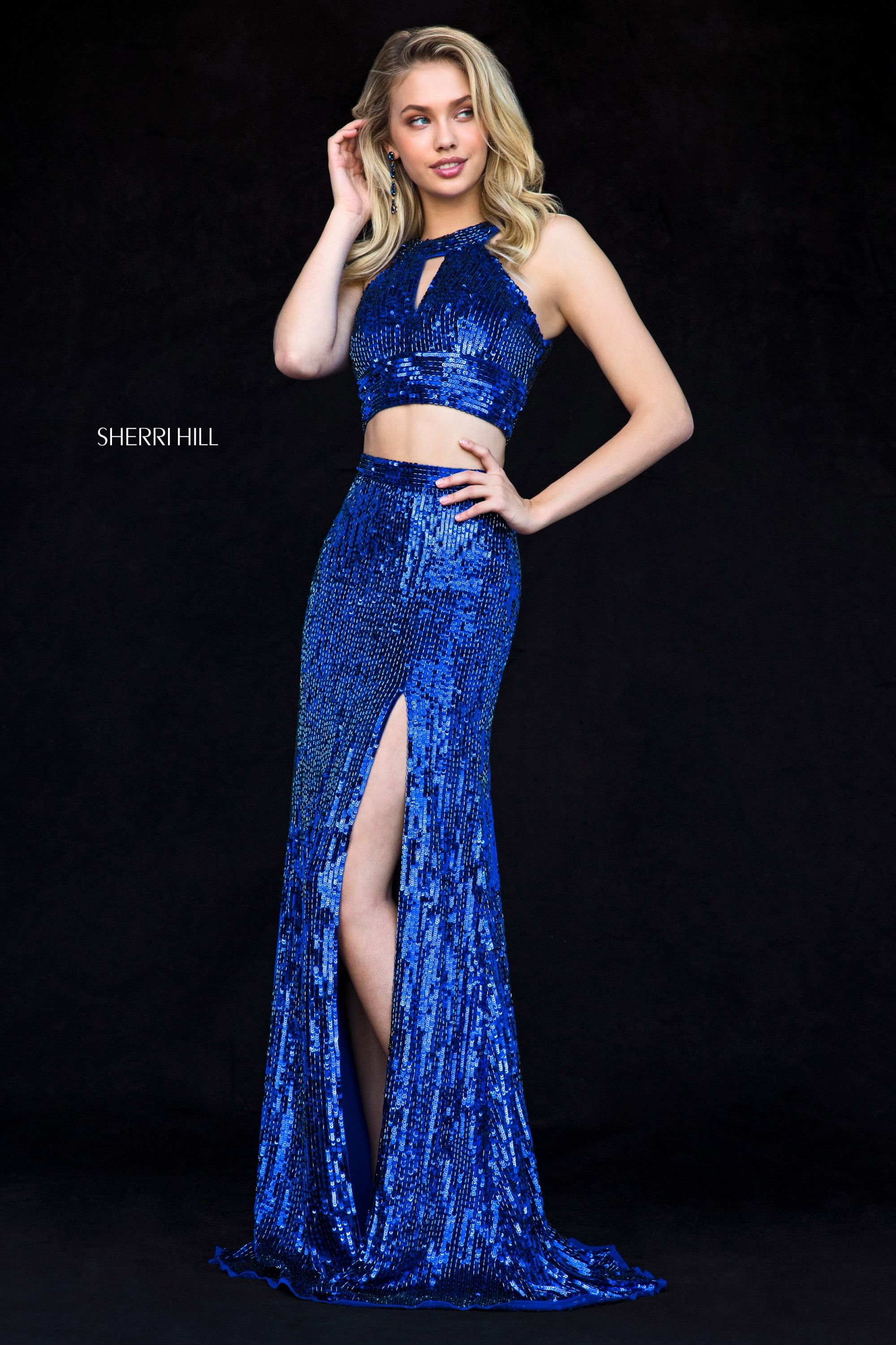 fad2e59c This Sherri Hill 51756 royal blue prom gown features a jewel neck crop top  with a front keyhole and cutout back, paired with a high slit column-style  skirt.
