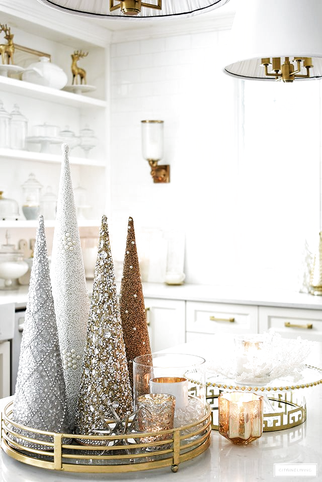 Gorgeous Christmas decorating ideas! Glittery trees gathered on a tray with mercury glass candles makes a glam statement! #christmasdecor #christmastrees #christmasdecorating #christmaskitchen #christmasideas #holidaydecorating
