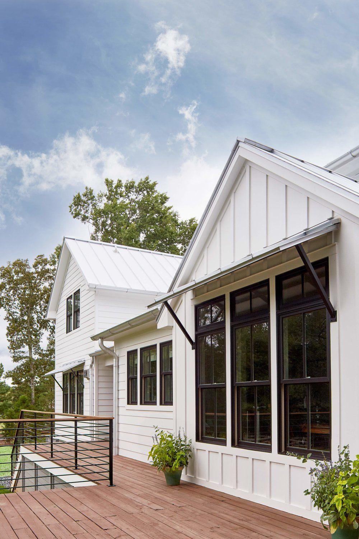 White Vertical Exterior Siding Black Trim Windows Window Awnings Dark Wood Decking Metal House Exterior White Exterior Houses Vertical Siding Exterior
