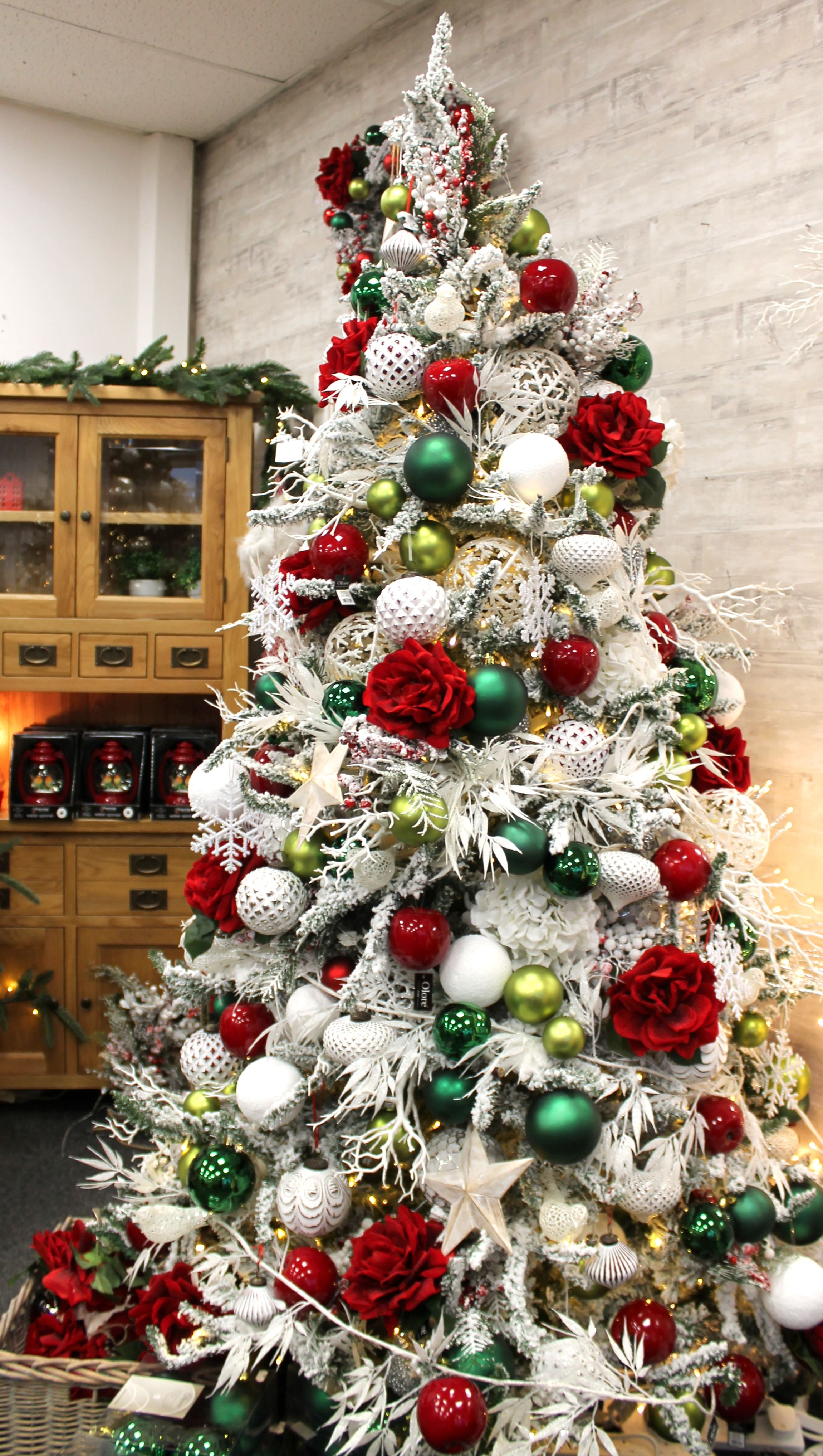 A Frosty Tree With Vibrant Red And Green Accents Christmas Tree Themes Christmas Tree Christmas Tree Inspiration