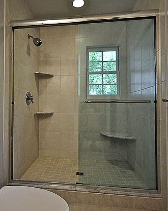 image of semi frameless sliding doors on an tiled shower enclosure