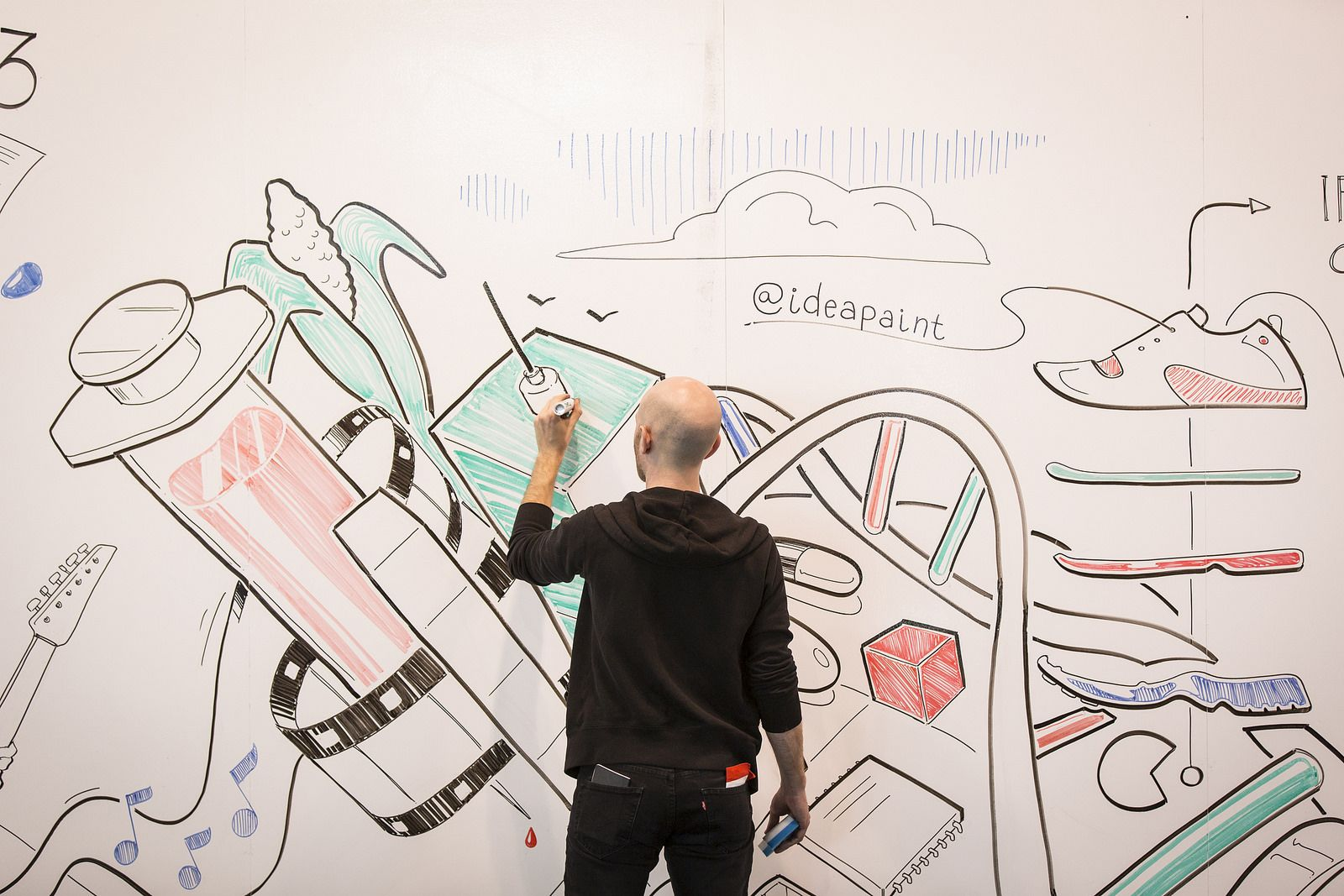Artist Derek Cascio colors on the walls of the Vancouver Convention Center, thanks to IdeaPaint—which turns any wall into a dry erase board. Photo: Ryan Lash/TED