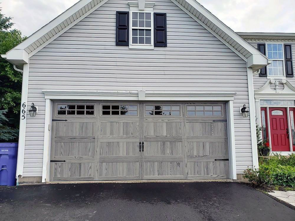 Stamped Carriage House Garage Door In Driftwood Accents Woodtones Carriage House Garage Doors Garage Door Styles Carriage House Garage
