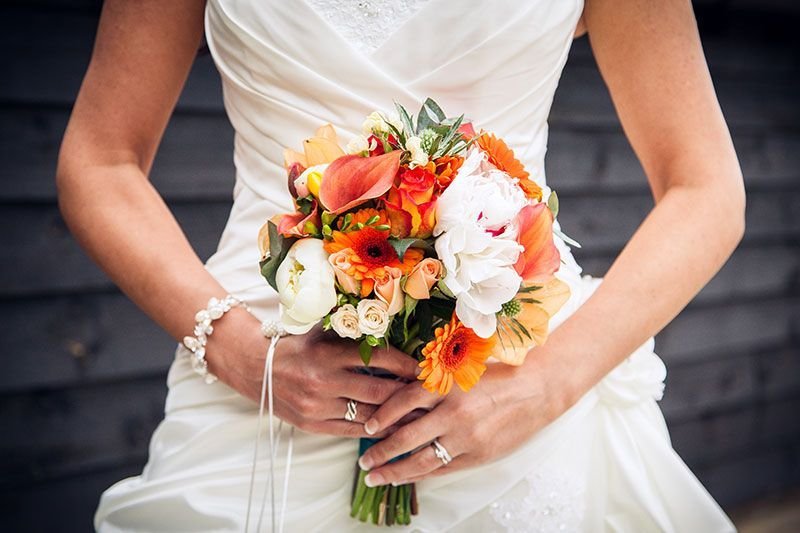 Vibrant Orange Bridal Bouquet  | FitzGerald Photographic | Sussex Wedding Photographer