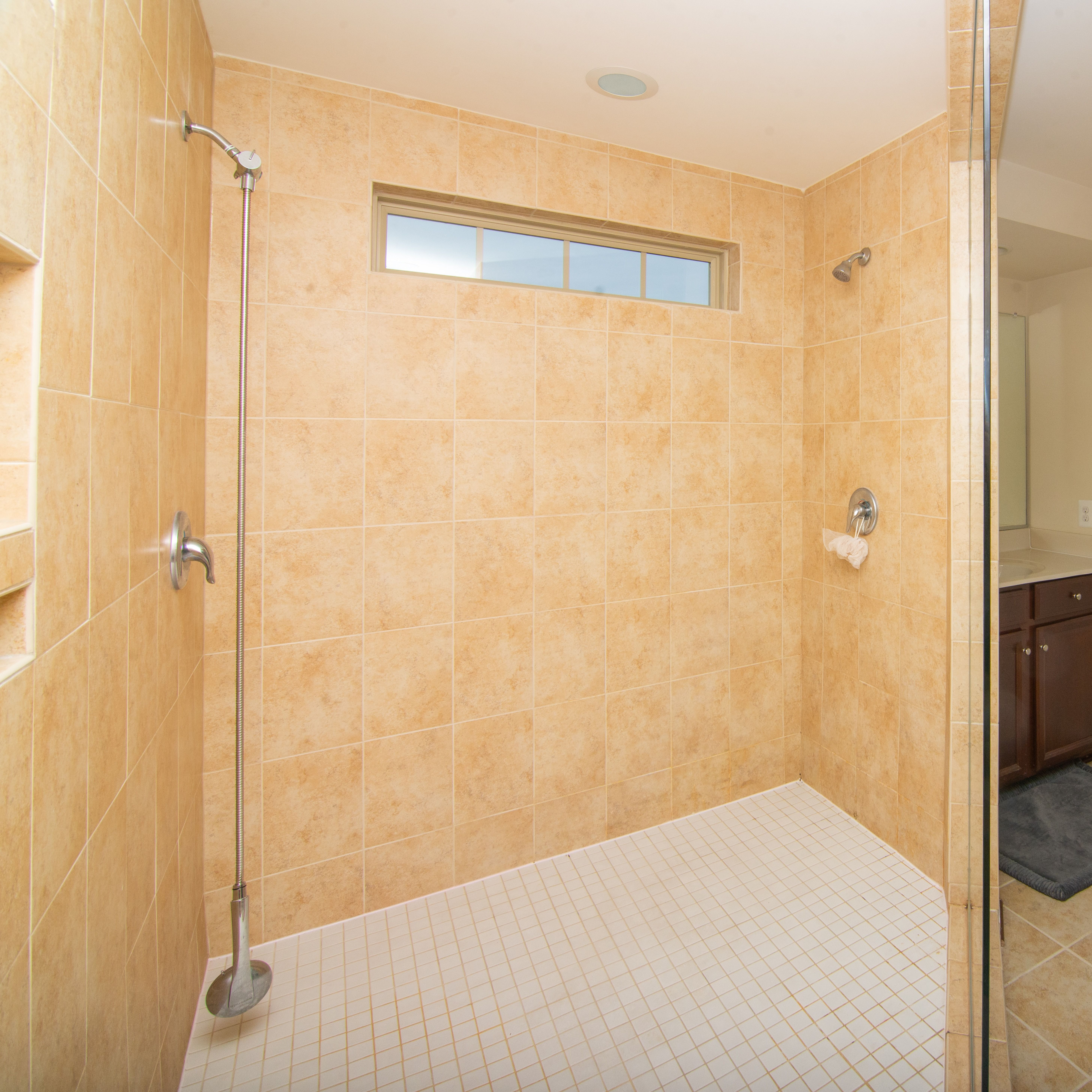 Luxurious Master Bathroom With Huge Tile Shower Located In The