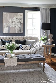 Dark Blue Walls Add Dimension To An Off White Sofa Misty Gray Curtains And A Pale Patterned Rug Gold Living Room Living Room Grey Silver Living Room