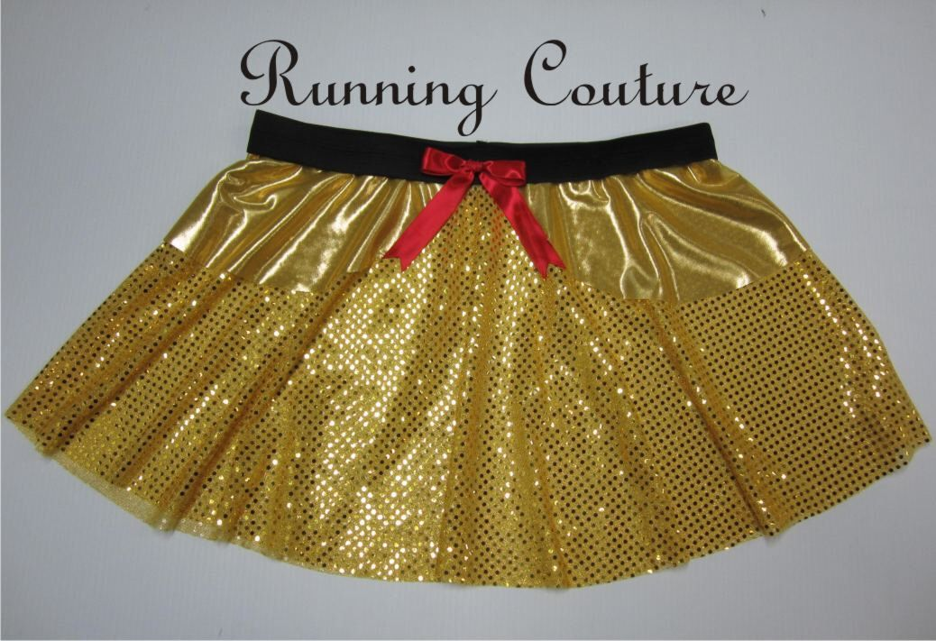 Belle inspired Sparkle and metallic gold Running Women's Round skirt accented with red bow by RunningCouture on Etsy https://www.etsy.com/listing/265137732/belle-inspired-sparkle-and-metallic-gold