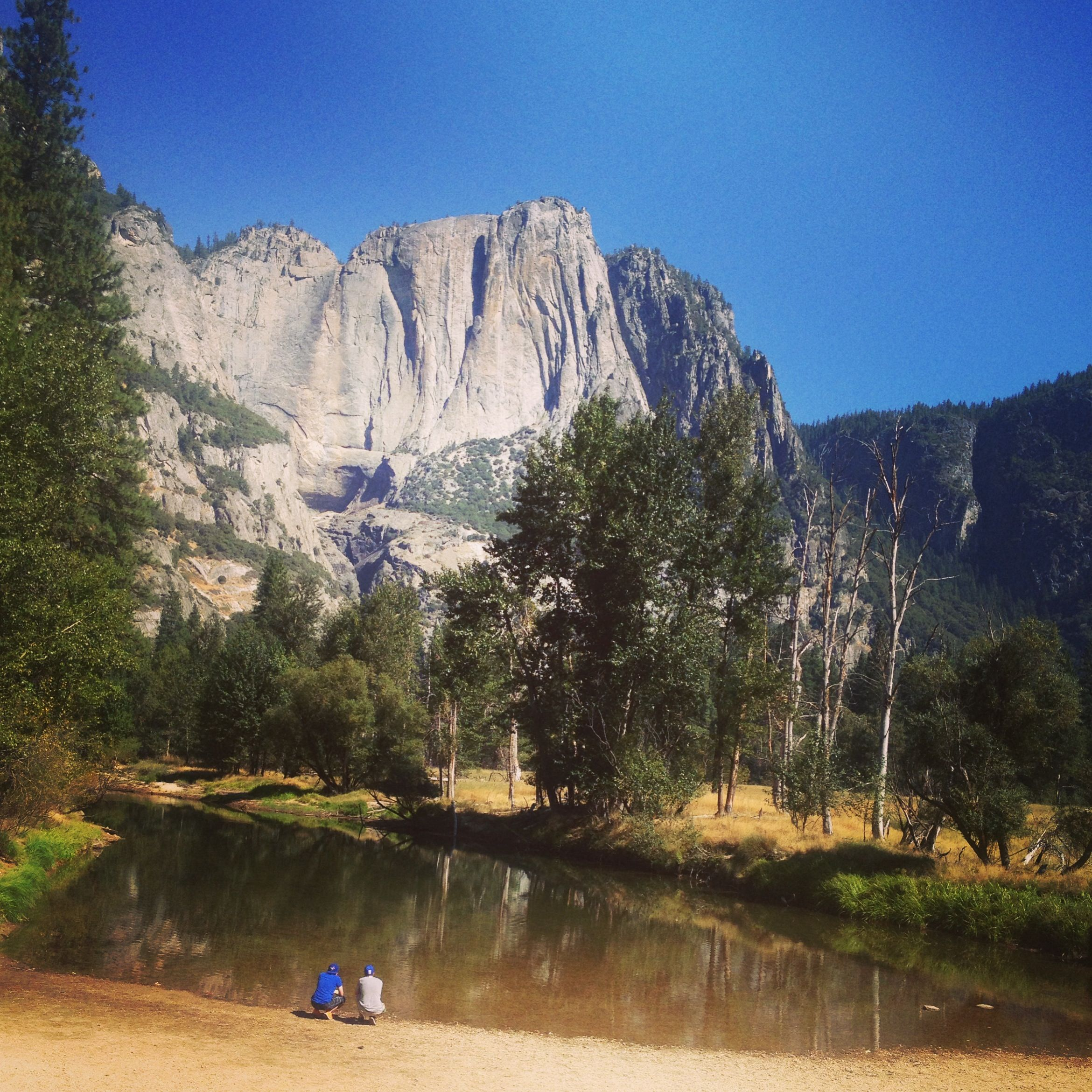 Yosemite National Park Rivers: Brothers Crouching At The Edge Of The Merced River In