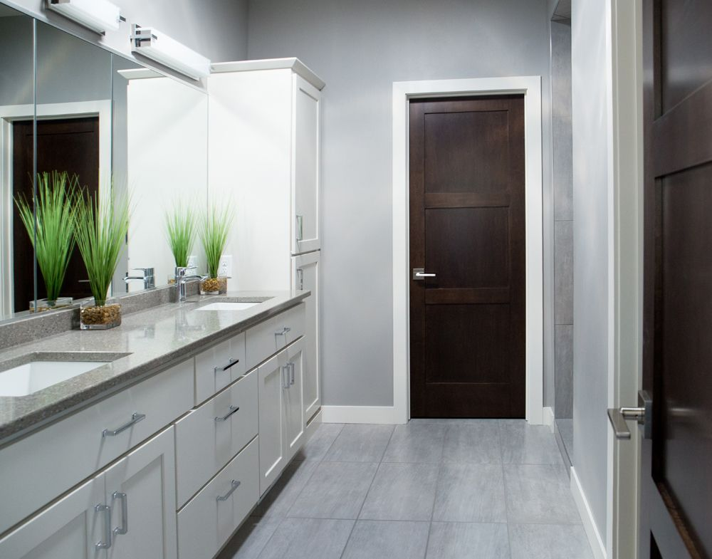 White Baseboard Trim with Dark Poplar Door White