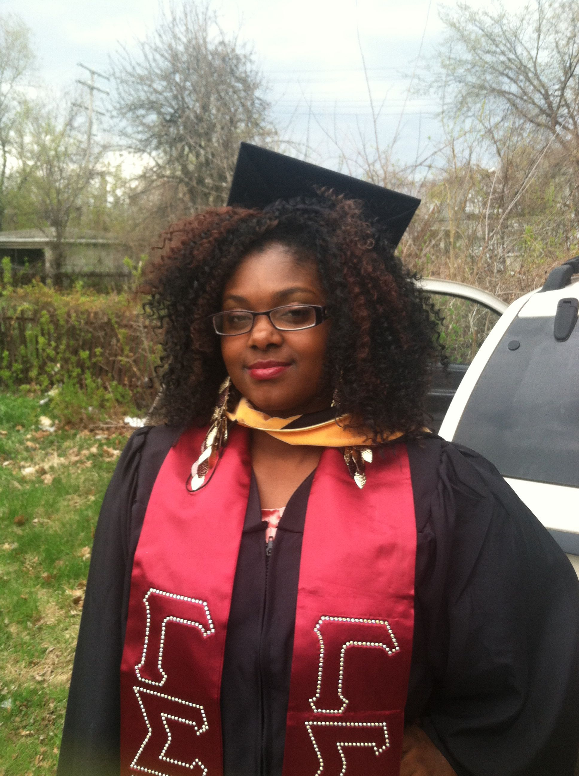 graduation cap and crochet braids