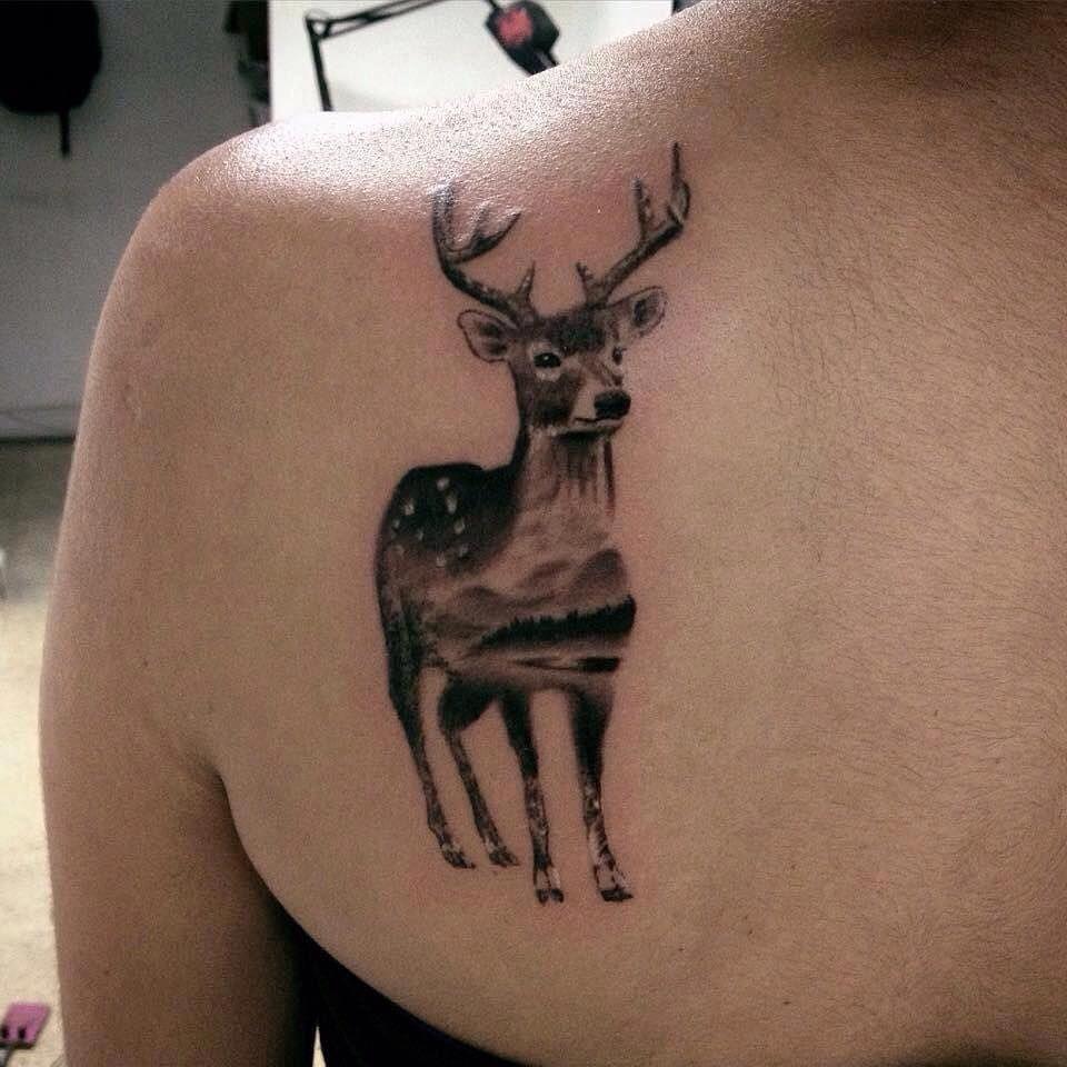 Black And Grey Deer Tattoo On Left Back Shoulder by Daniel