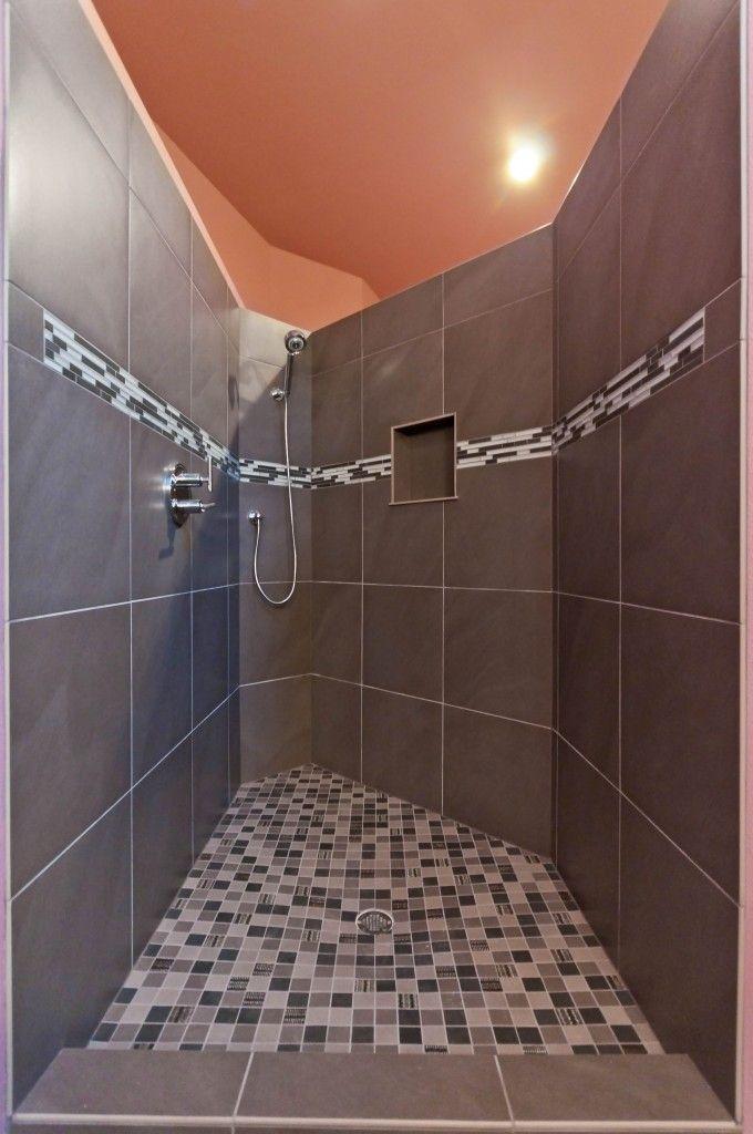 Large walk in, doorless tile shower Gray slate tile with white