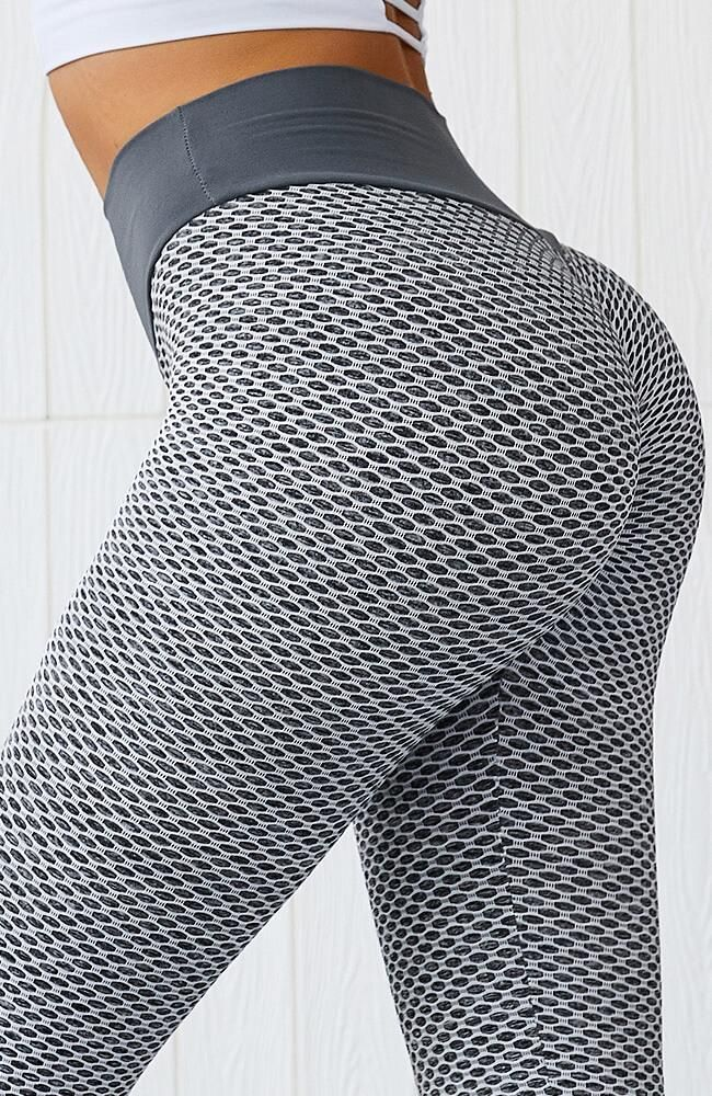 """Want a sexy and chic look? The Density Legging would definitely be your favourite!Designed with high waist to offer tummy   Details:   Made of nylon, spandex/polyester.  Lightweight and stretchy.   Model is 5'6"""" and wearing a size small"""