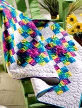I love these bright cheerful colors and the beautiful quilting!