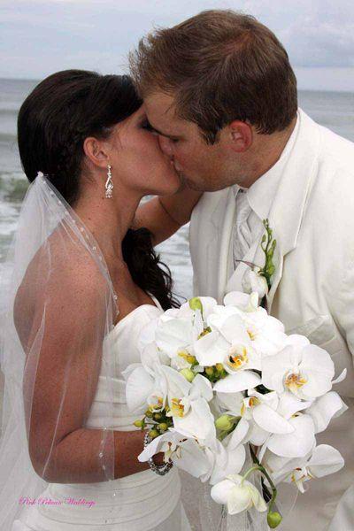 Pink Pelican Weddings - Tropical White Bridal Flowers #WhiteCascadingBridalBouquet #PhalaenopsisOrchids #SebastiantFlorist #WeddingFlowers #FloridaWeddings #BridalBouquet www.verobeachweddingflowers.com www.facebook.com/pinkpelicanweddings www.sebastianflorist.com https://twitter.com/PinkPelican1