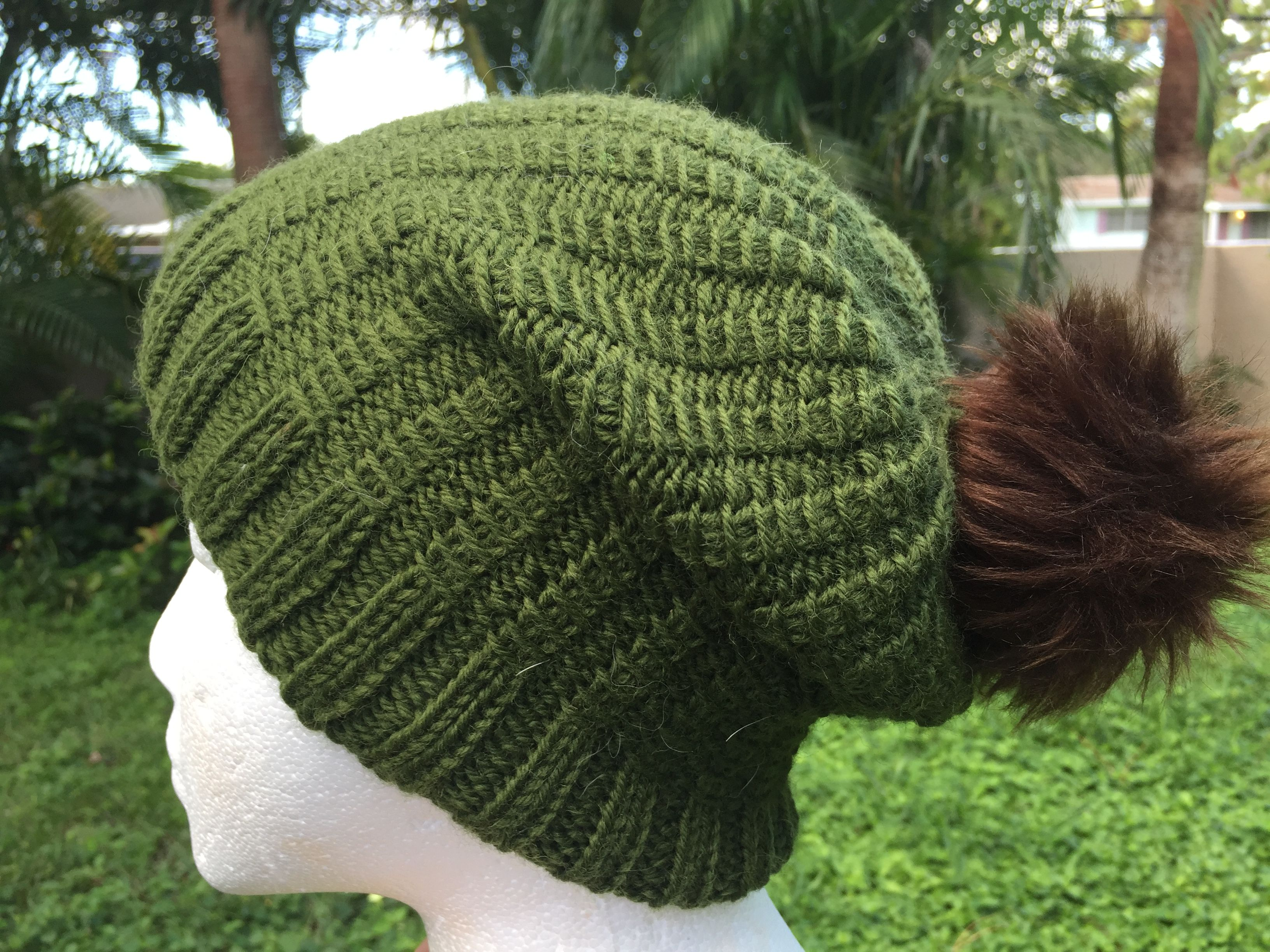 Green Hand knit beanie hat with pom pom on manequin | Hats | Pinterest