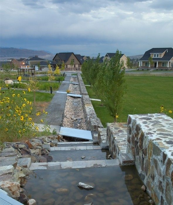 Stormwater canals carry water to a series of constructed for Local landscape designers