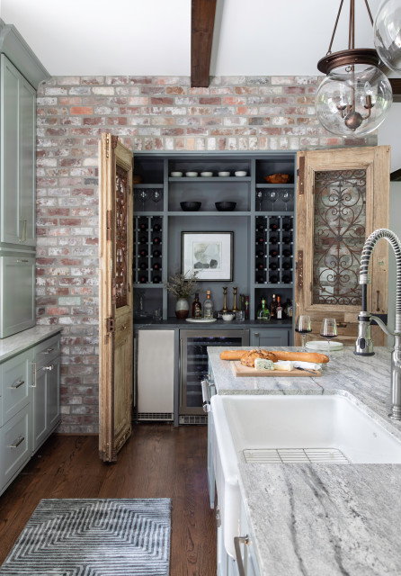 Gray-green cabinets with used brick, antique door on wine ...