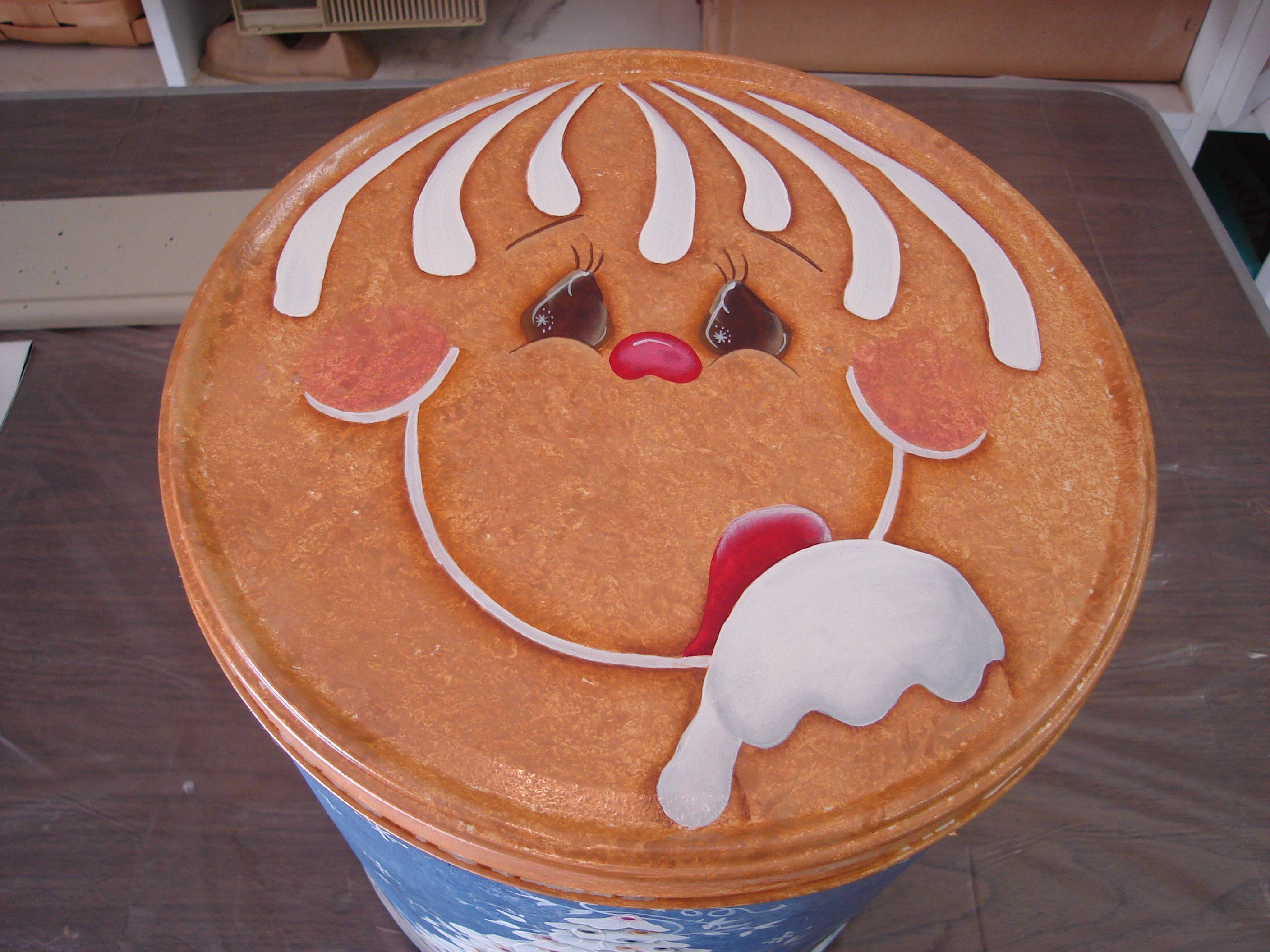 This is a hand painted lid to a can that can be filled with goodies to give family, friends, or neighbors