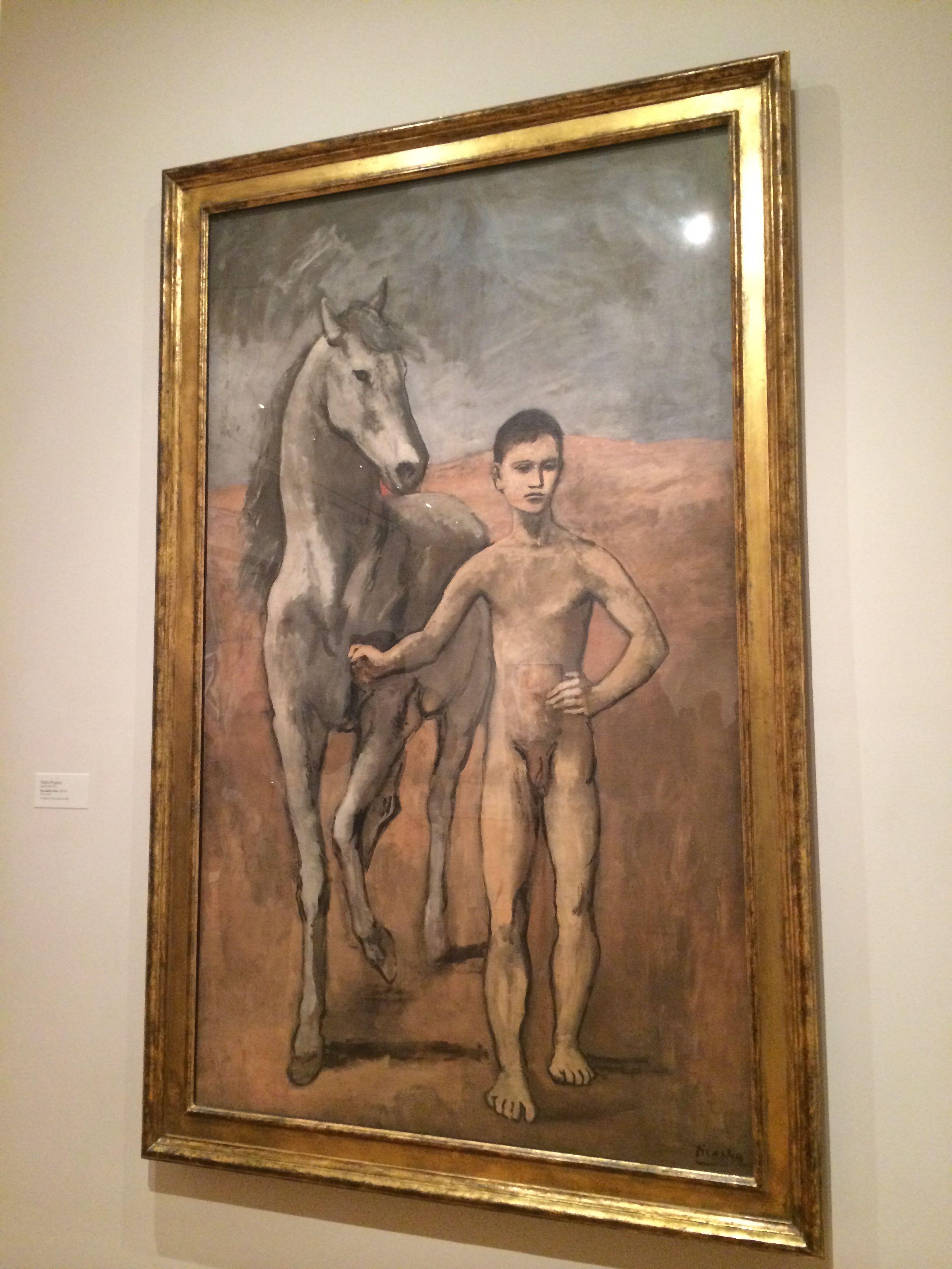 Pablo Picasso's boy leading a horse
