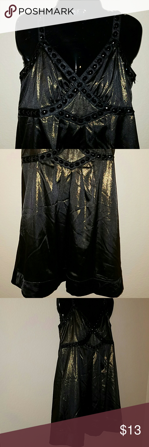 NWT Sexy Metallic Tunic Pretty shiny top with beading. Adjustable straps. Zipper on the side.  Brand new. Great for the holidays or new years eve! Tops