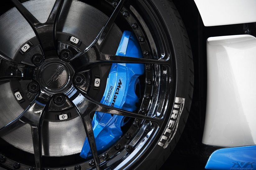Pur Wheels With Blue Brake Calipers Wrapped In Pirelli Tires
