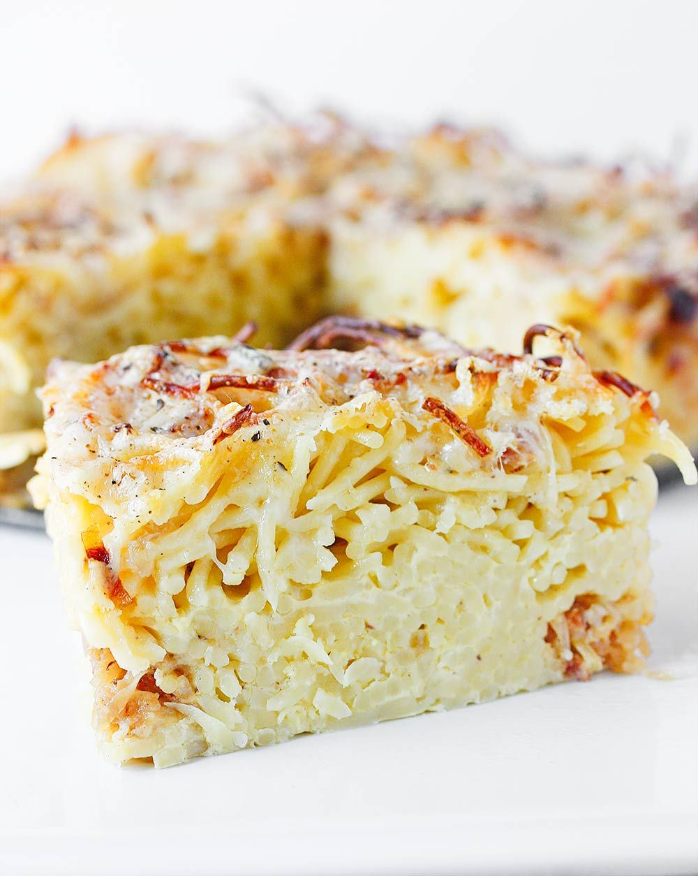 The classic American comfort food gets a super fun preparation: baked into a sliceable spaghetti pie stuffed with cheese and savory caramelized onions.