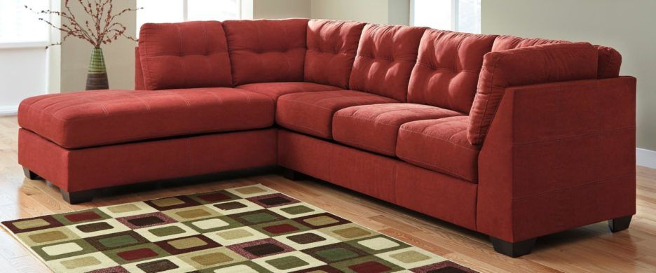 Apartment Ashley Furniture Futon  Red Sectional L Shape Sofa Smooth Big Seat Sofa Simple Cushion In Red Tone Square Colorful Flooring Carpet  Ashley Furniture ...