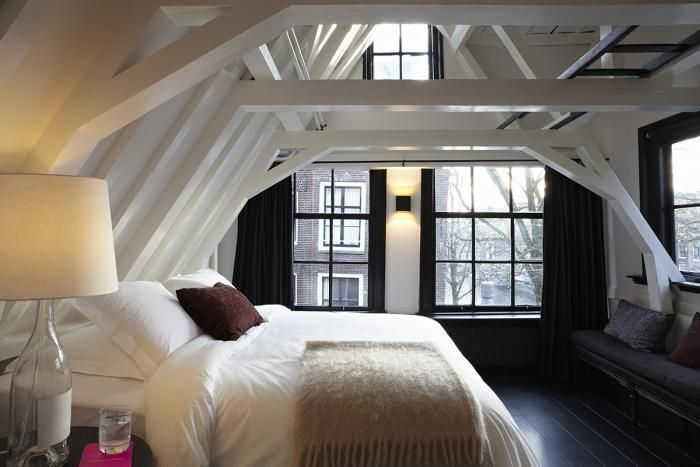 love this attic loft bedroom - all white bed with black floor and window details (amsterdam bedroom of designer ulrika lundgren)