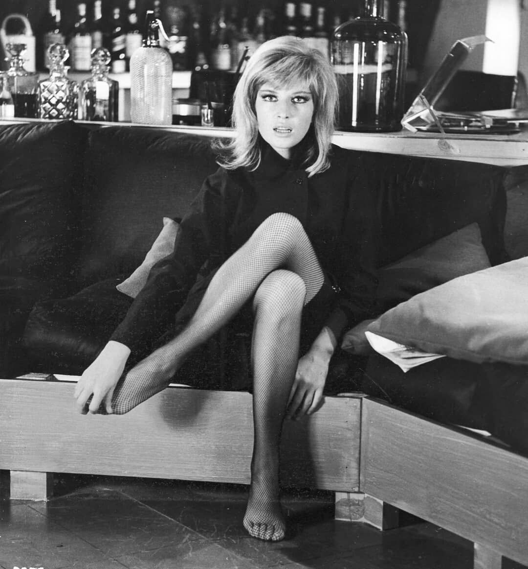 Publicity shot Monica poses for the camera whilst between takes shooting a scene in Paul Hagan's Amsterda… | Italian actress, Pose for the camera, Classic actresses