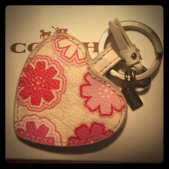 NWOT Coach Heart Keychain with Tassel This one is New WITHOUT Tags..had multiples and the one with tags sold and it won't let me change the listing now😬. Adorable Coach Keychain in the shape of a heart! White leather with pink flower design and an attached white tassel! Keyring has tiny cute Coach hang tag. Makes a great gift! Coach Accessories Key & Card Holders