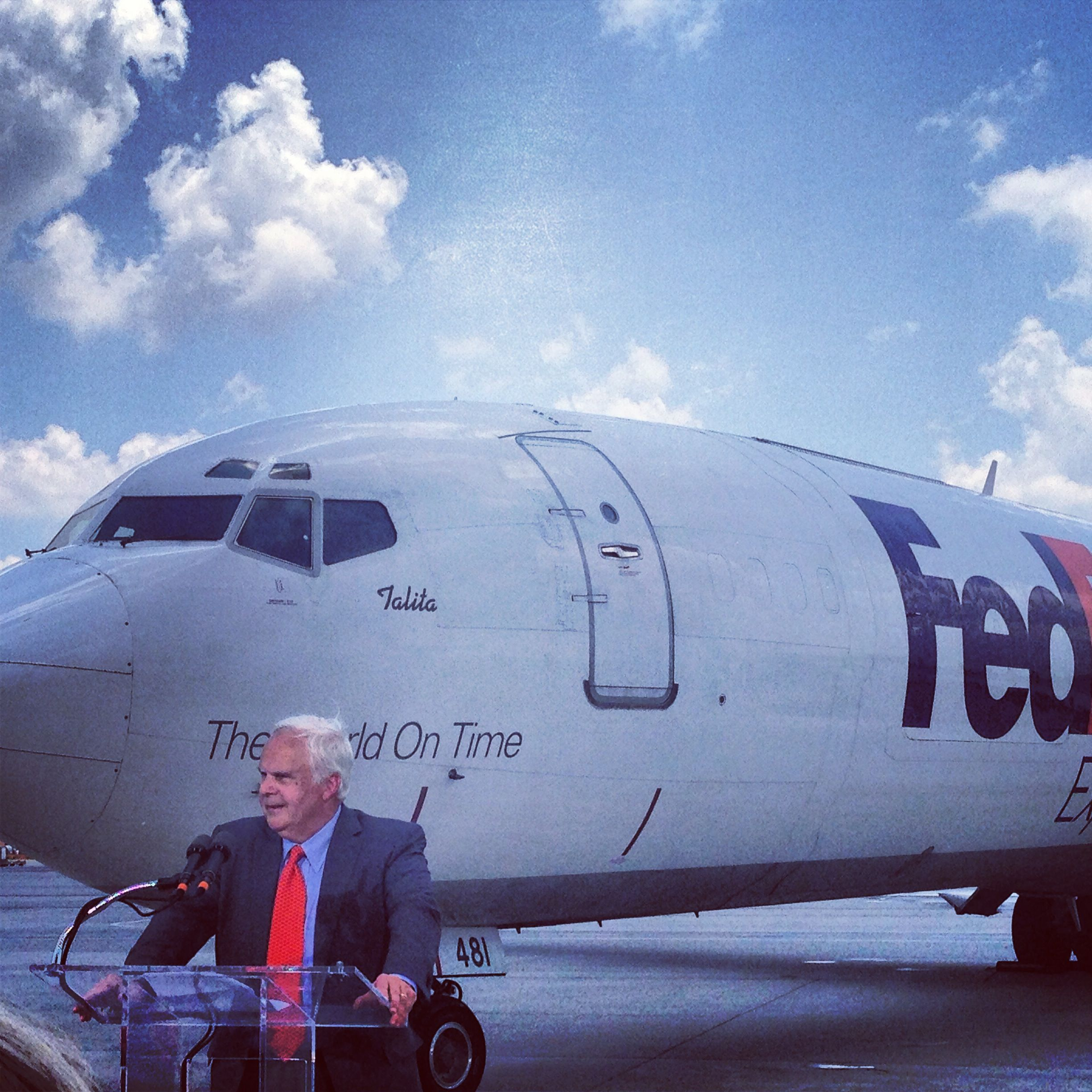FedEx Founder and Chairman Fred Smith in front of the last