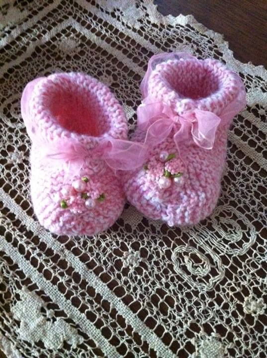 Simple Knit Baby Booties Embellished With Pink Ribbon Pearls And
