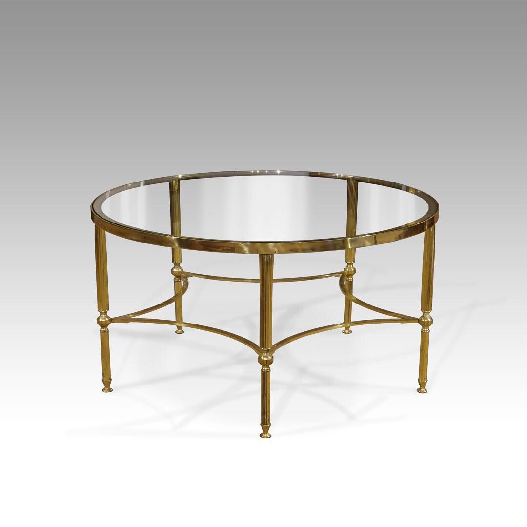 So rare to find a circular glass coffee table this one is so rare to find a circular glass coffee table this one is gorgeous too with finely reeded brass legs and a star shaped under tier in the shop now geotapseo Gallery