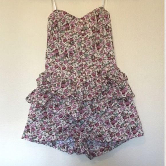 Floral romper Cream & magenta floral romper. Super cute! Has Ruffles & Pearl buttons, sweetheart neckline & is strapless. Back has stretch material so it can work with many bust sizes. Worn once for British tea. Brand new condition (not Anthro) Anthropologie Pants Jumpsuits & Rompers