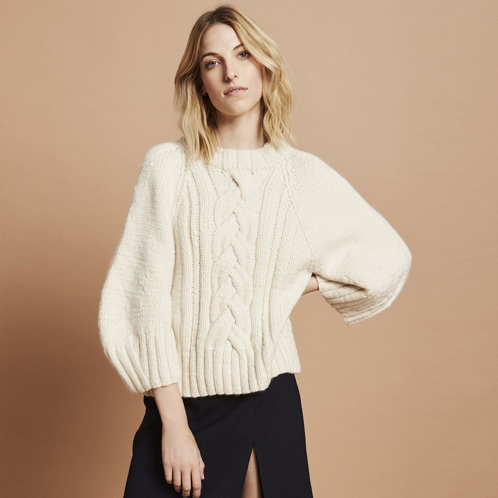 This cozy, cream-white, merino wool cable-knit fisherman sweater ...