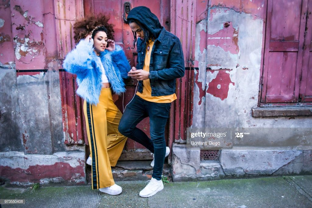 Young Couple Listening To Music Through Headphones On Smartphone Photography #Ad, , #sponsored, #Listening, #Couple, #Young, #Music