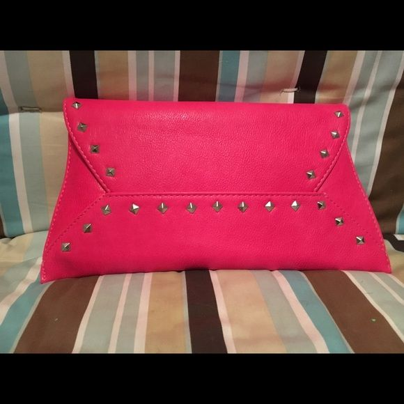 Hot Pink Clutch with studs Never been used! Hot pink and comes with detachable strap. Bags Clutches & Wristlets