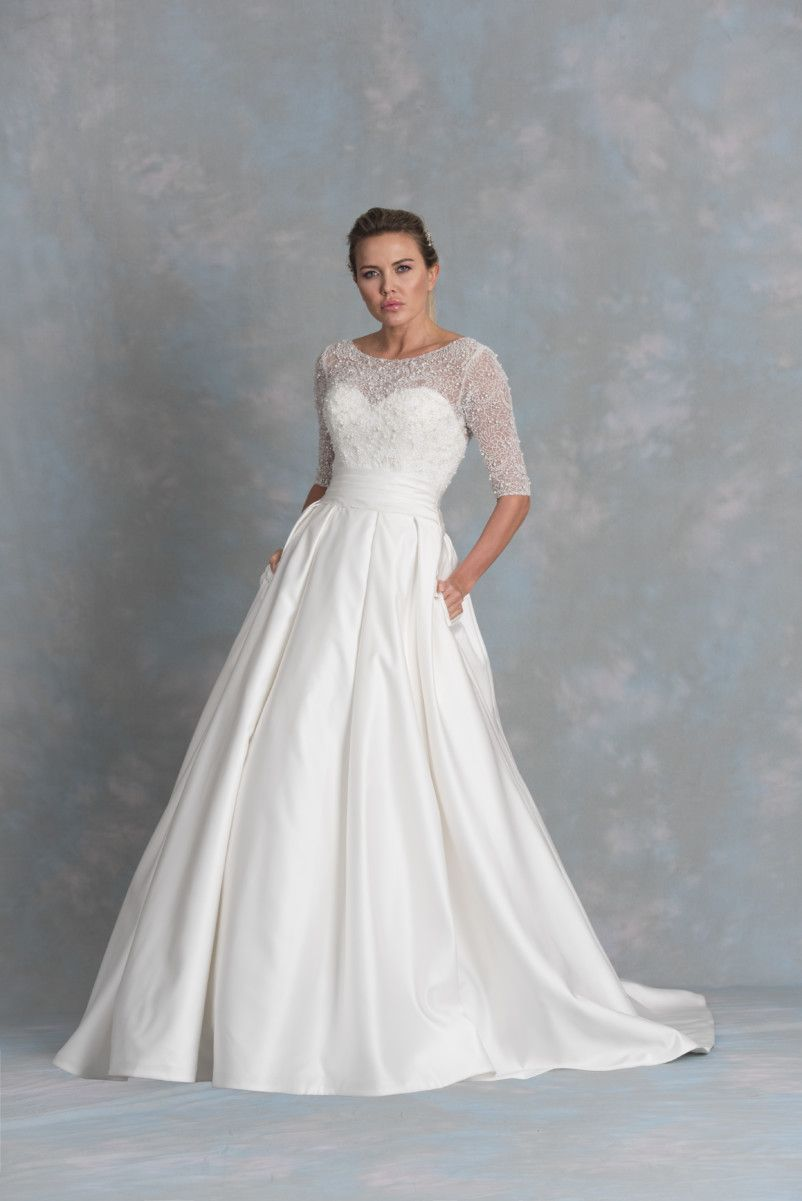 A show stopping creation of a satin ball gown with stunning illusion