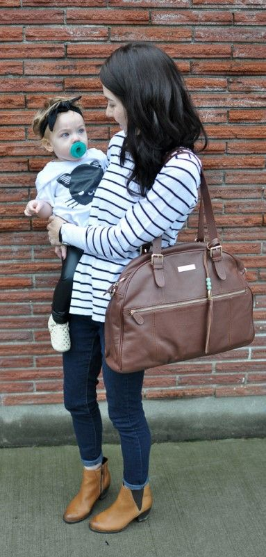 """Ever shy away from purchasing a diaper bag because you were afraid it would make you look too """"mom-ish""""--and then struggle with all your baby gear getting all jumbled together and bottles spilling everywhere? Enter: Lily Jade diaper bags! They are classic, luxury diaper bags that can be worn 3 ways (including BACKPACK!)...and have over 16 POCKETS to keep all your baby things exactly how you want them. Also? They just make you look GOOD! Click to purchase the Rosie today!"""
