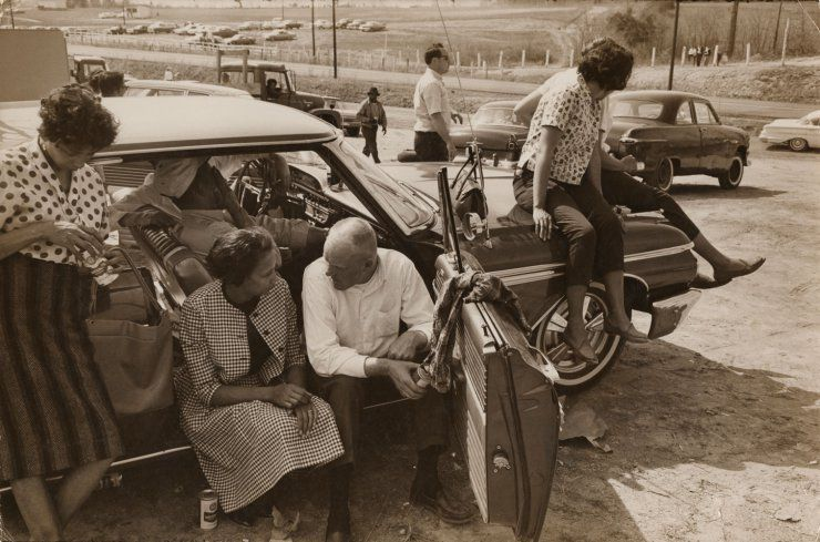 Richard and Mildred Loving sit in a car celebrating Richard's win in a race at Sumerduck Dragway, Sumerduck, Virginia, April 1965.