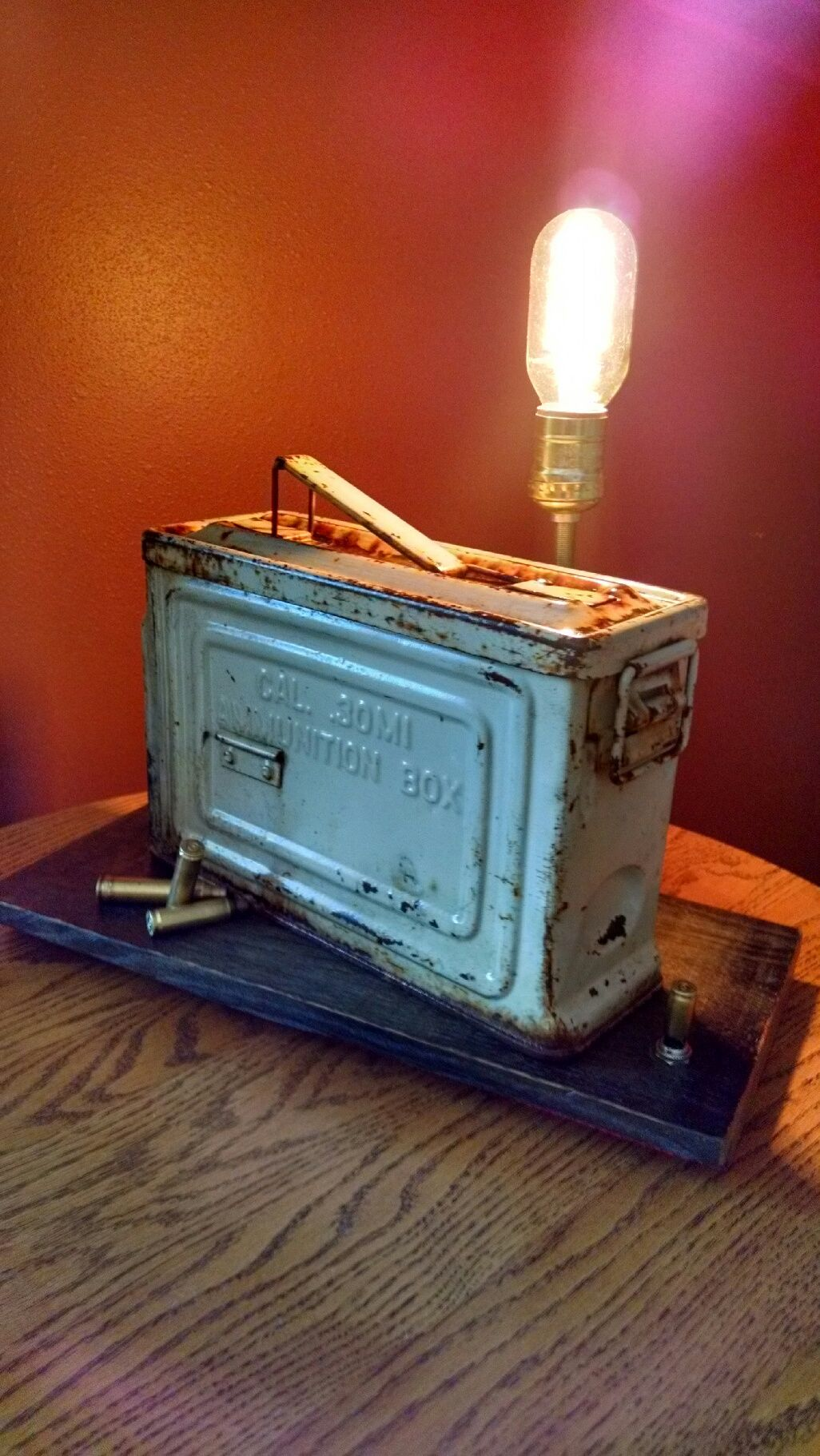 """neat old ammo box and brass shell casings teamed up with an """"edison"""" style bulb makes up this unique vintage accent light.....push button casing switch... https://www.facebook.com/pages/Skramstad-Primitives/340184592831655?ref=bookmarks"""