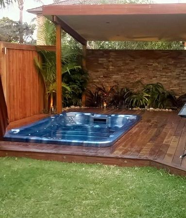 Small backyard tropical oasis tropical garden pool for Pool design sydney