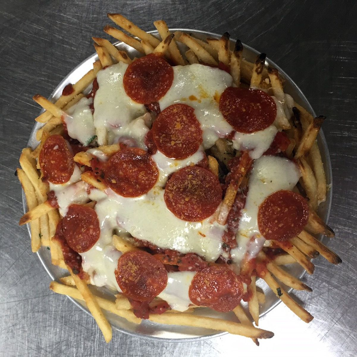 Homemade Pepperoni And Cheese PIzza French Fries Stock ...  Pepperoni Pizza French Fries