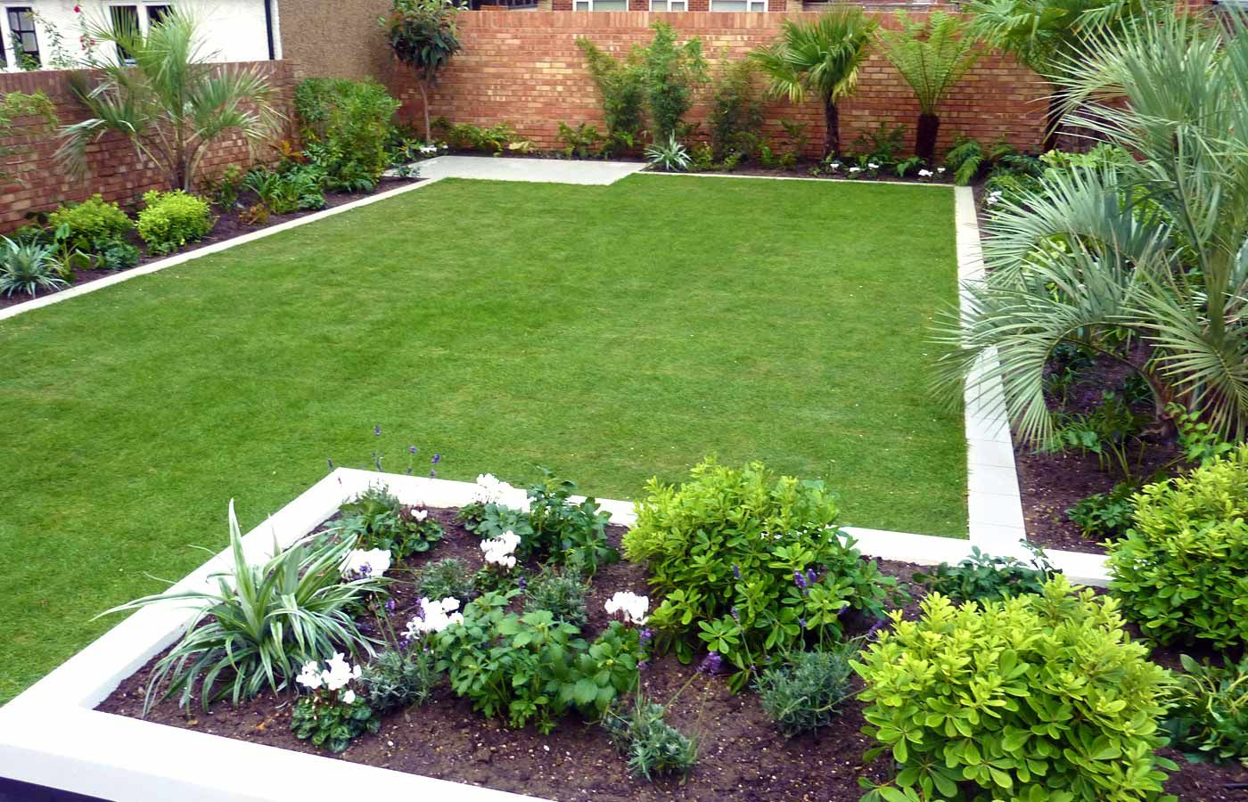 Simple Backyard Outdoor Garden with Large Green Grass and Some Palm Trees  Decorating also Brick Fence for Modern Garden Design Ideas