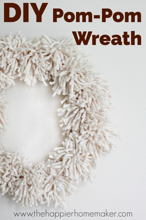 DIY Giant Pompom Wreath I have to make one of these! Step by step tutorial on this blog.