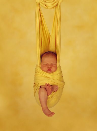 Baby in yellow sling