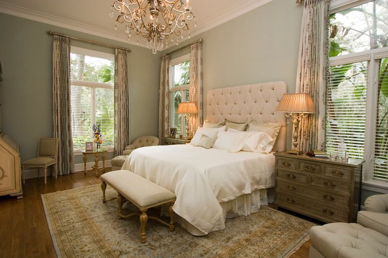 Traditional Bedroom With Fabric Headboard And Blinds Paired With