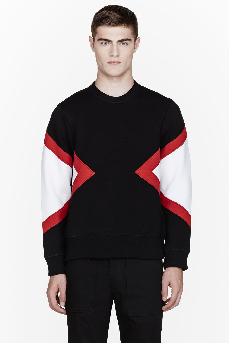 NEIL BARRETT //  Black colorblocked sweatshirt  32368M055005  Long sleeve boxy sweatshirt colorblocked in black, red, and white. Ribbed crewneck collar, cuffs, and hem. Tonal stitching. 95% viscose, 5% elastane. Hand wash. Made in Portugal.  $480 CAD